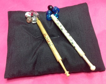 """2 lace bobbins from the 1800s in bone and ivory and beaded ends 4""""(10cm) long."""
