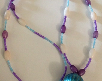 17 inch long blue, purple and cream beaded lanyard
