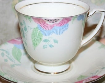 Royal Doulton England Nerissa Red Blue and Green Tea Cup and Saucer Art Deco