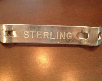 """Vintage """"church key"""", Sterling Beer."""