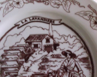 Lovely Hand painted La Lavandiere (Laundry washmaid) plate .  Made in France.