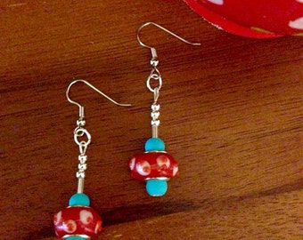 Set of lamp work red and turquoise bead earrings.