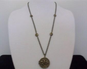 Antique brass octopus locket.