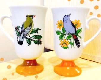 Pair of adorable vintage pedestal bird mugs