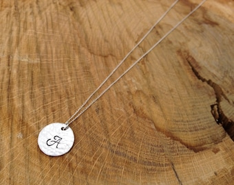 Beautiful hand stamped initial necklace on delicate sterling silver chain
