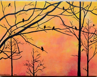 Crows in trees at sunrise