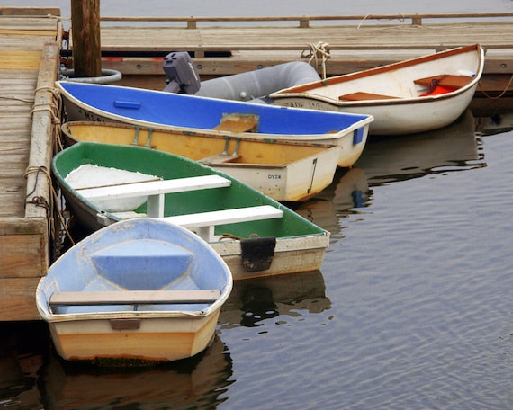 Colorful Wooden Row Boats Tied To Dock In By