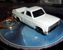 custom made rare keychain 1983 chevy silverado fleetside pick up truck,gloss white w/chrome rims on black mags/repaint-mint
