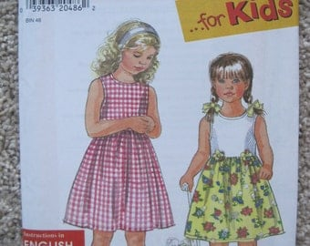 UNCUT Girls Dress - Size 2 to 6X - Simplicity Sewing Pattern 7710