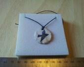 Round blue bird ceramic pendant