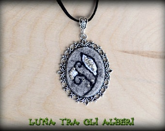 Pendant with embroidery on felt