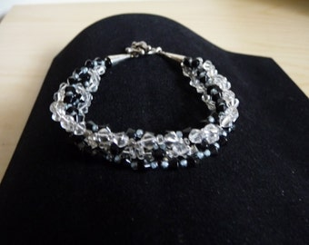 Black and clear crystals, loops intertwined bracelet.