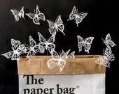 10 Mariposas 3D con recortes interiores, color blanco brillante. Da vida a tu casa, a tu fiesta o haz un regalo bonito y divertido.