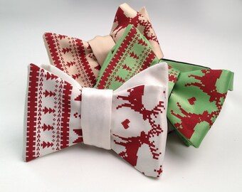 Christmas Sweater bow tie. Iconic ugly holiday sweater silkscreen print. Men's bowtie. Tacky red reindeer, poinsettia, snowflake design.