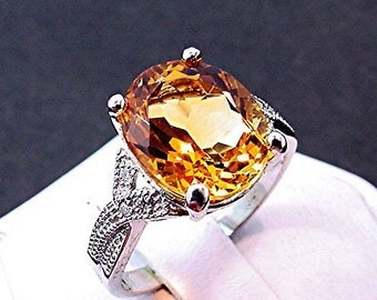 AAAA Golden Citrine   12x 0mm  4.45 Carats   in a 14k White or 18K gold ring with diamonds (.08ct) Ring 0359