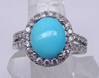 AAAA Natural Untreated Sleeping Beauty Turquoise 12x10mm 3.65 Carats 14K white gold halo ring set with .80cts of diamonds  0202