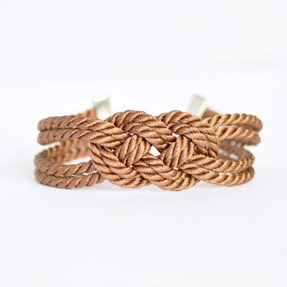 Shiny brown double infinity knot nautical rope bracelet with silver anchor charm