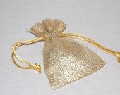 Favour bag in shimmering gold with a cord