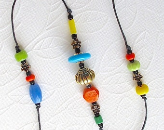 Beaded Wind Chime: Garden Chime. Multicolor Opaque Glass Beads. Fiesta Colors. Turquoise. Yellow. Blue. Orange. Green. Black. Brass Bell
