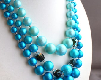 Vintage triple strand turquoise blue faux pearl beaded necklace
