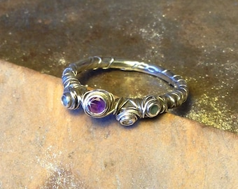 Handmade recycled silver ring set with amethyst, aquamarine & CZ.