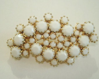 White and Gold Tone Brooch.