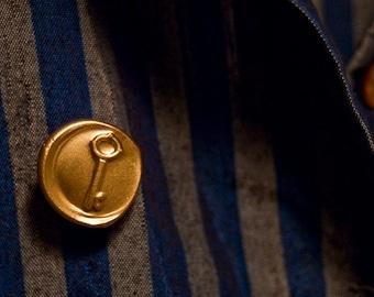 gold key wax seal lapel pin