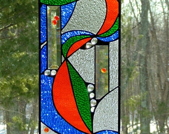 Stained glass window panel, abstract ribbon art decor, contemporary, blue orange green, bright colorful suncatcher panel, modern home decor