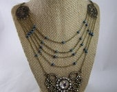 Anna May Wong- Multi-strand necklace with blue beads and vintage heart-shaped rhinestone pendant