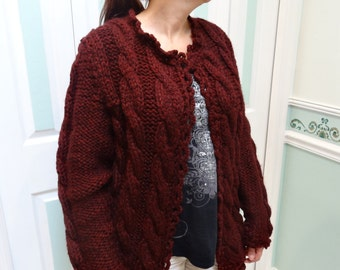 LADIES SWEATER: Bulky ,claret , hand knitted sweater/coat, cable pattern stitch , size medium to large, photo's 1 & 2 are  exact color
