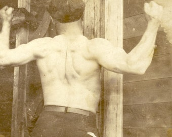 Unusual Photo of MUSCULAR MAN With His BACK To The Camera Photo Postcard Circa 1910