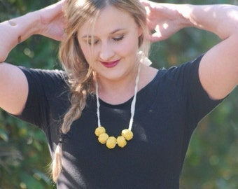yellow linen wood necklace with cream ribbed organic cotton