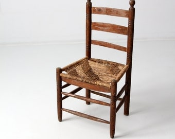 antique rush seat chair with ladder back