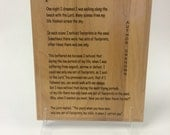 """Footprints in the Sand 8"""" by 10"""" engraved into a red alder plaque"""