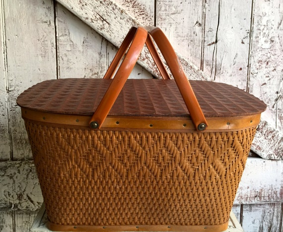 Vintage picnic basket wicker with metal handles brown looks like a Redman basket comes with picnic plates cups