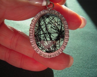 Black Tourmaline Rutilated Quartz From South Africa set in Sterling Silver Palladium......ON SALE
