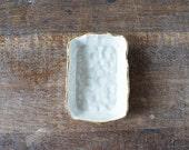 white and gold stoneware soap dish