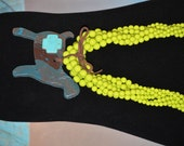 Chocolate and Turquoise Show Goat Necklace with Cross on a Lime Green Necklace