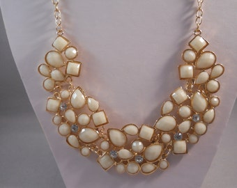 Bib Necklace with Gold, Cream and Clear Rhinestone Pendants on a Gold Tone Chain
