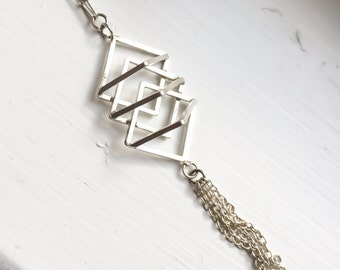 Sterling silver geometric necklace with tassel