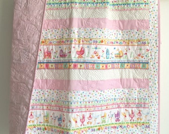 Baby Girl Quilt with Baby Storks and Baby Buggies Pink Blue Green Red Orange Yellow White