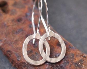 Sterling silver hoop drop earrings, small textured silver ring earrings for everyday, handmade sterling silver earrings by ARC Jewellery UK