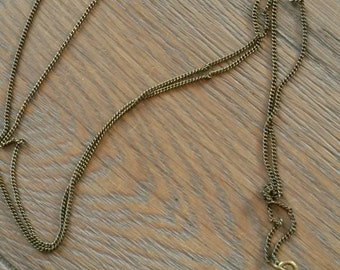 Brass chain necklace with an oillamp pendant