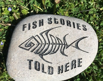 Engraved Stone, Fish Stories Told Here.