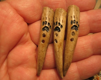 Hand carved deer antler point wolf track button or toggle reproduction