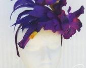 purple fascinator featuring silk irises & satin bowes on headband for spring / summer wedding or racing carnival