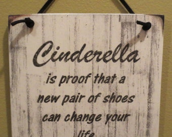 Cinderella is proof that a new pair of shoes can change your life sign