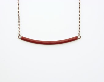 Handmade enameled necklace; curved bar in wine red. Adjustable chain.