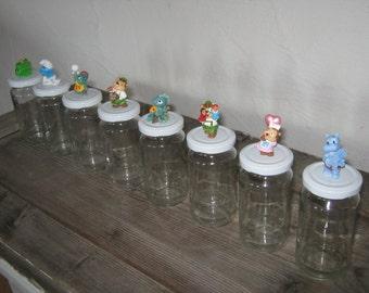 Jam jar with sweet Überraschungseifigur on top