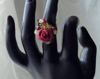 RR30B Beautiful burgandy rose ring, with burgandy and green crystals, wrapped in brass wire size 6